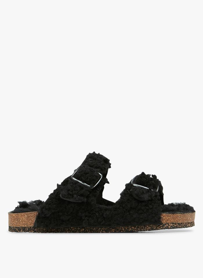 BOSABO Sandalias planas de piel de oveja con bridas en negro