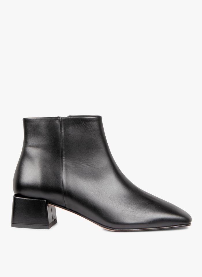 BOBBIES Boots à talon en cuir Noir